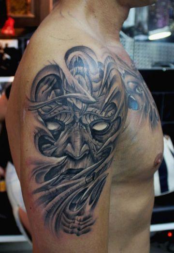 tatuajes de demonios en el brazo a grises