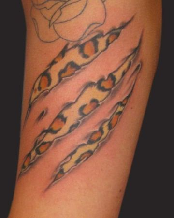 tatuajes de garras para hombres piel desgarrada