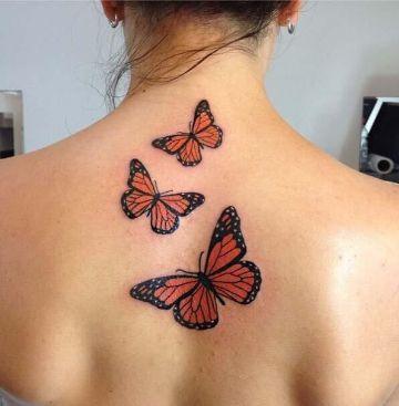 tatuajes de mariposas en la espalda para mujeres en vuelo