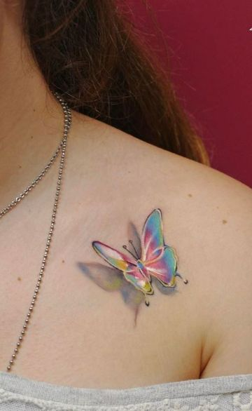 tatuajes de mariposas blancas con color