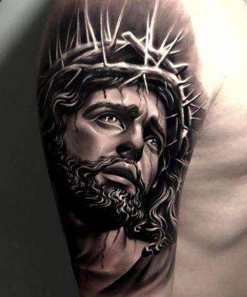 tatuajes de jesucristo en el brazo realistas