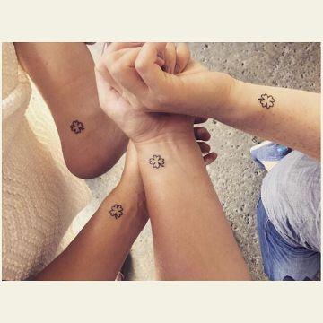 tatuajes de familia de 4 en diferentes partes del cuerpo
