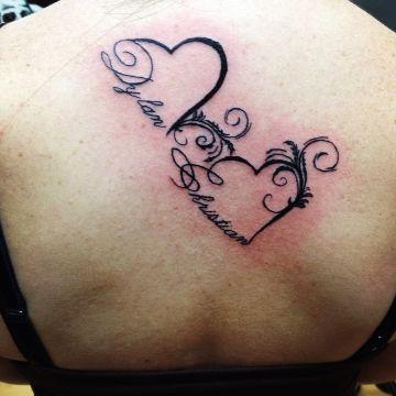 tatuajes de corazones con letras grandes compromiso