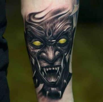 tatuajes demoniacos oscuros con toques de color