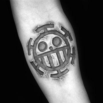 tatuajes de one piece simbolo en piedra