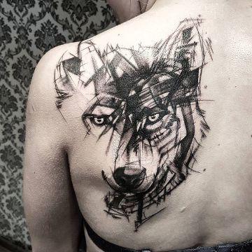 tatuajes de lobos en la espalda tipo trash polka