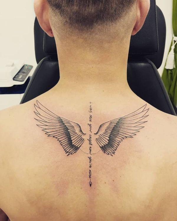 tatuajes de alitas de angelito en espalda con frases