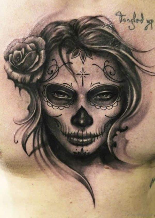 tatuajes de rostros en el pecho de catrinas