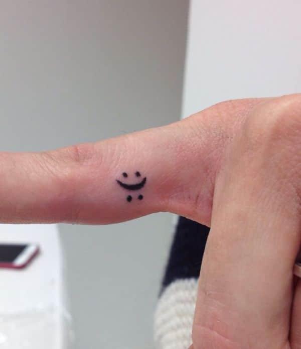 tatuajes de cara triste y feliz creativo