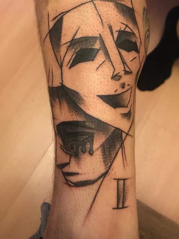 tatuajes de cara triste y feliz efecto original