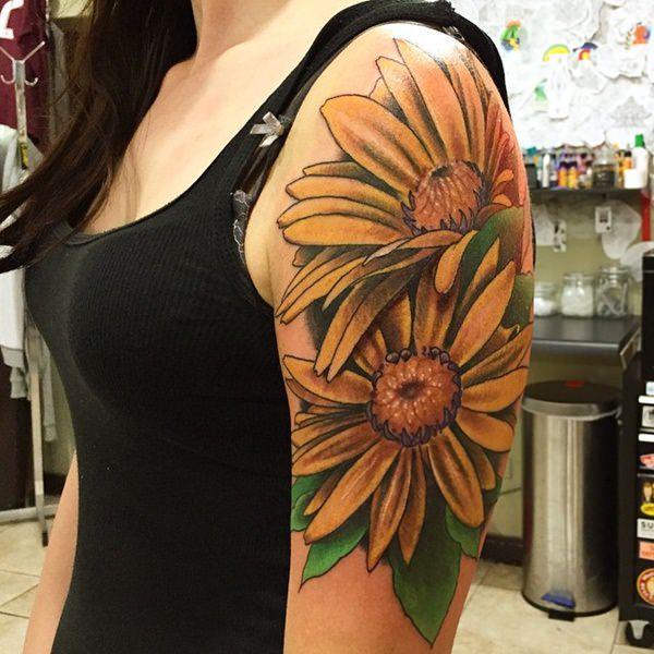 tatuajes de margaritas en el brazo colores