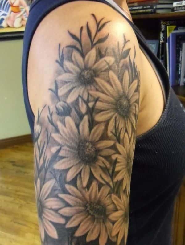tatuajes de margaritas en el brazo medio espacio