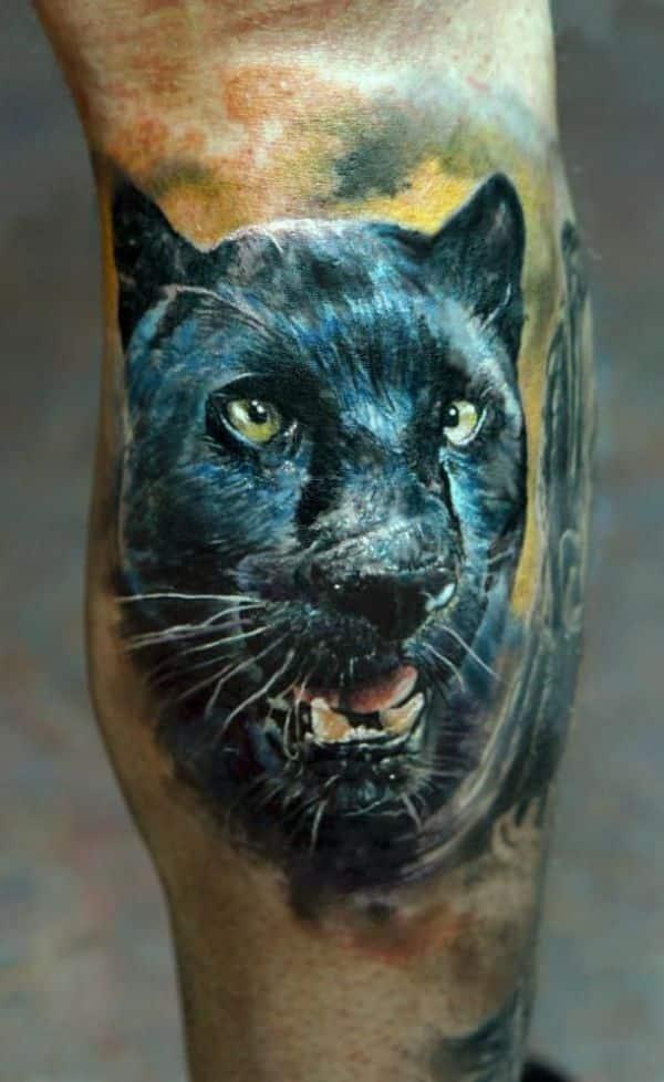 tatuajes de panteras en el brazo alto detalle