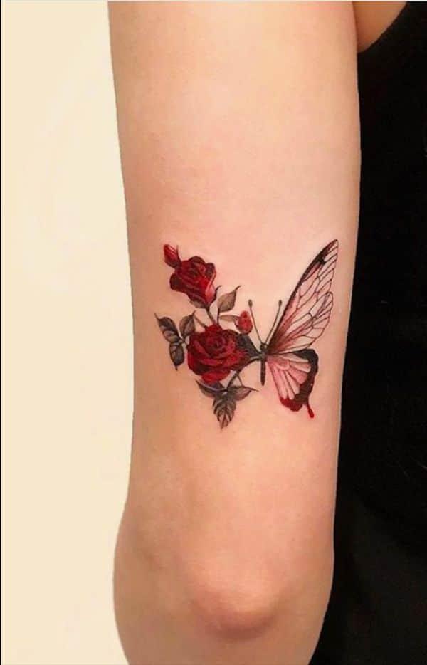 tatuajes de mariposas con rosas en brazo