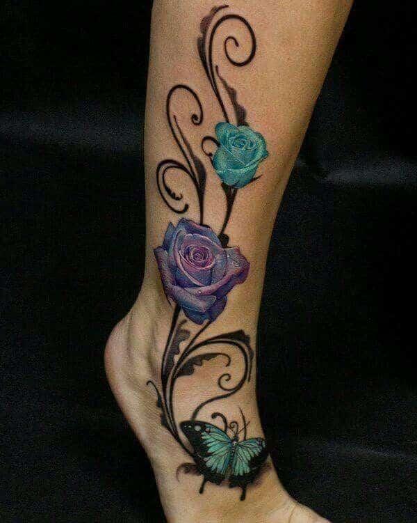 tatuajes de mariposas con rosas en piernas