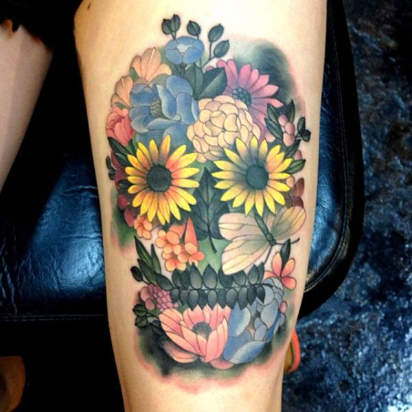 tatuajes de calaveras con flores conjugación